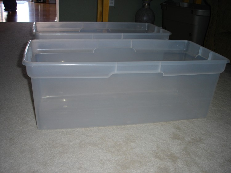 now that we have our materials and tools in hand its time to start planning our hole placement a total of 8 holes will be drilled for these containers 4 - Rubbermaid Tubs